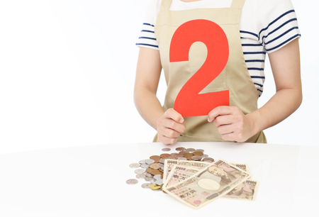 Woman with a number Stock Photo