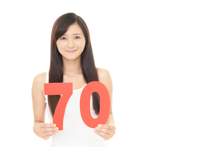 seventy: Woman with a number Stock Photo