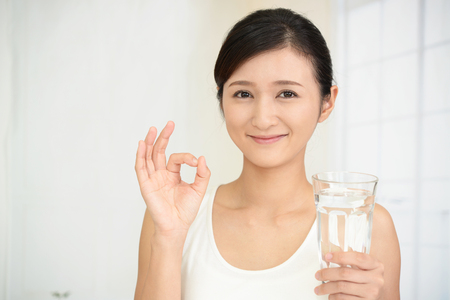 lifeline: Woman drinking a glass of water