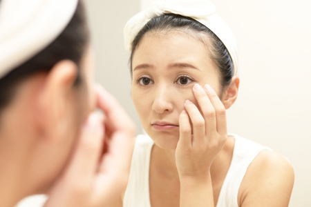 Young woman having skin problems Standard-Bild