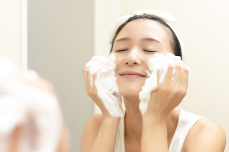 Woman washing her face 스톡 콘텐츠