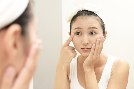 Young woman having skin problems 写真素材