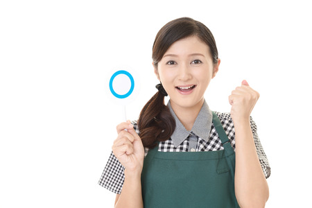 Smiling waitress with a Yes sign