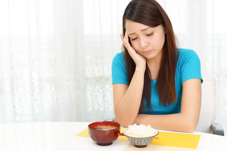 Woman has no appetite Stock Photo