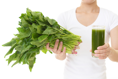 Woman with a glass of vegetable juice