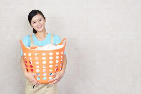 Woman with a laundry basket Reklamní fotografie