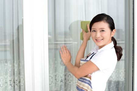 Smiling woman cleaning the house
