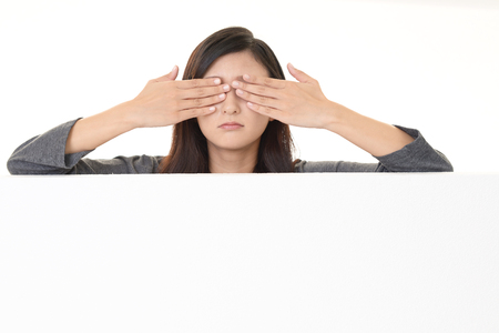 Young woman covering her eyes 写真素材