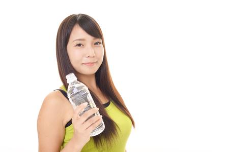 lifeline: Woman drinking a bottle of water