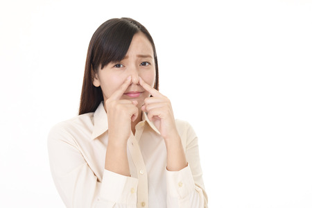 Woman pinches her nose