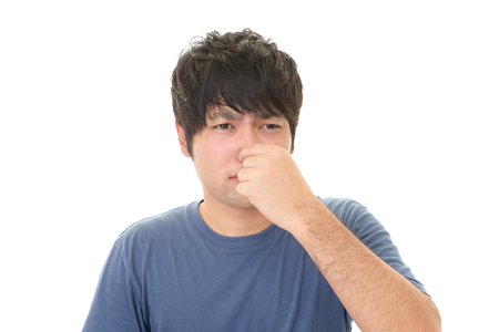 Man pinches his nose Stock Photo