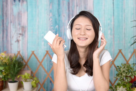 healing with sound: Woman listening to music