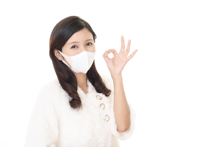 Woman wearing a flu mask