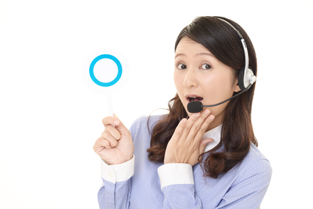 Call center operator with a Yes sign