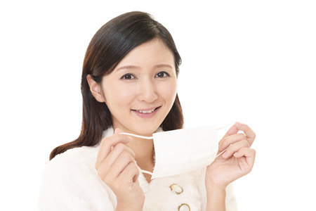 Woman holding a flu mask Stock Photo