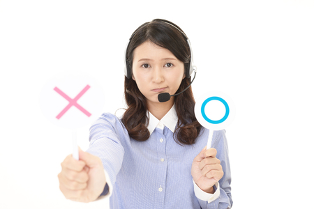 Call center operator with a Yes or No sign