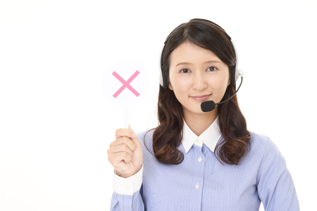 Call center operator with a No sign
