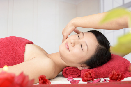 Woman getting a facial massage Stock Photo
