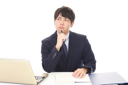 Working Asian businessman