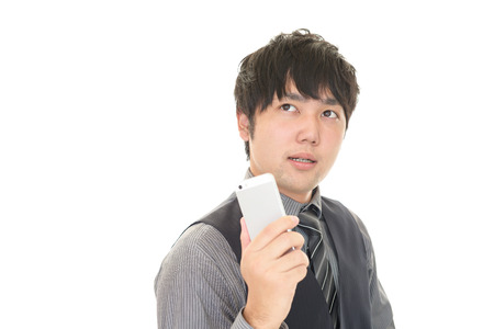 liveliness: Businessman holding a smart phone Stock Photo