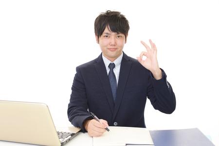 liveliness: Businessman gives OK sign Stock Photo