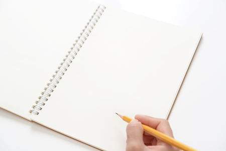 necessities: Notebook and pencil Stock Photo