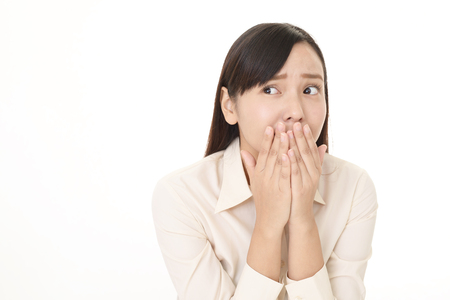 embarrassment: Woman who is worried Stock Photo