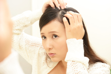 Woman looking unhappy with her hair
