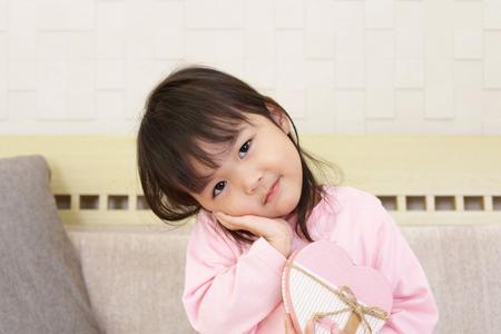 小さなアジアの女の子の笑顔 写真素材