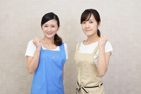 Smiling women in apron