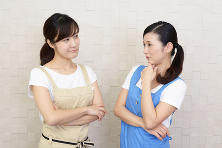 Uneasy Asian women Stock Photo - 86162841