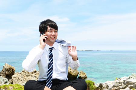 The man who relaxes on the beach. Stock Photo