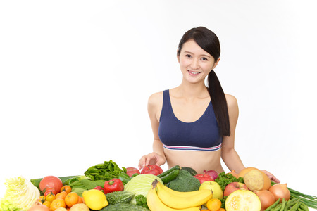 Woman with vegetables Stock Photo