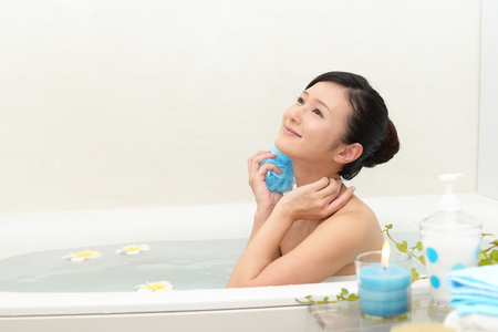 Young beautiful woman taking relaxing bath