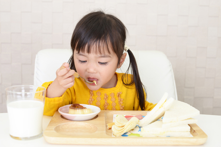 Little girl eating foods