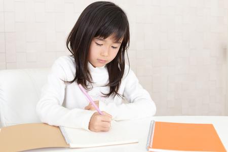 Portrait of an Asian schoolgirl Фото со стока