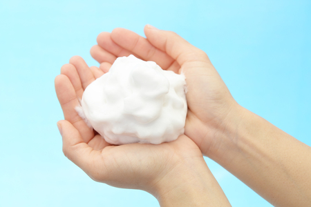 Foam of soap and female hands