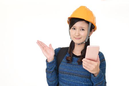 Woman wear a safety hat