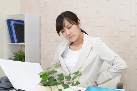 Tired and stressed Asian business woman