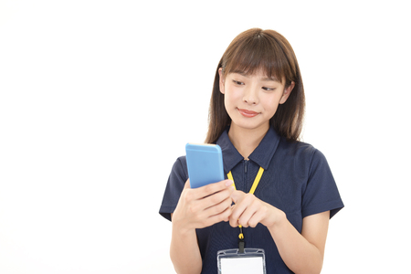 Female worker with a smart phone