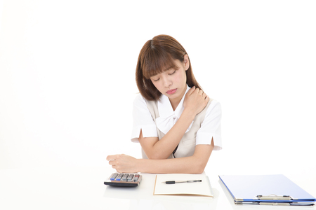 Business woman who has a shoulder pain. Stock Photo