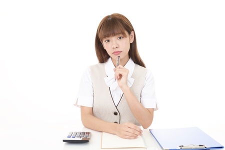 Uneasy Asian business woman Stock Photo
