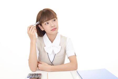uneasy: Portrait of business woman looking uneasy
