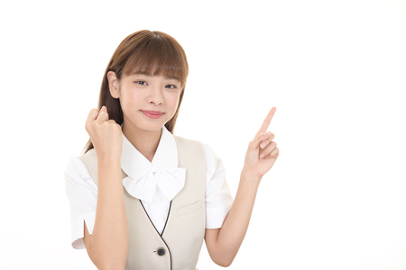 The female office worker who poses happily Stock Photo