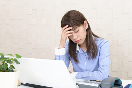 Tired and stressed Asian business woman Фото со стока - 90854471