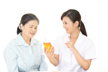 A friendly pharmacist and an elderly woman Imagens
