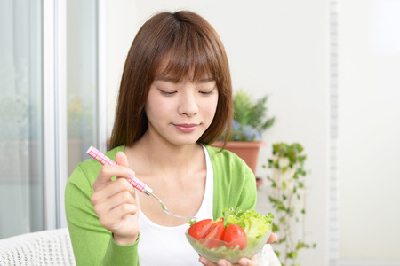 Woman who enjoys a meal Stock Photo