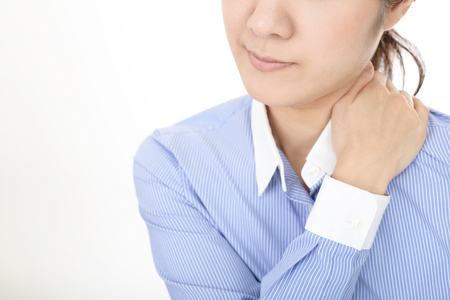 Woman who has a shoulder pain Stock Photo