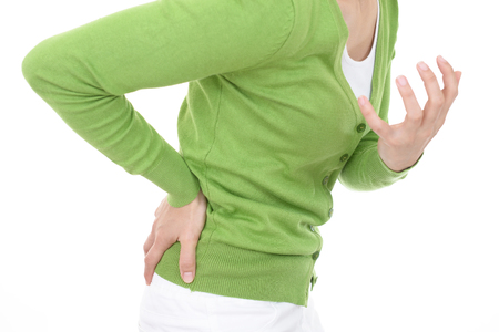Woman who has a back pain Stock Photo