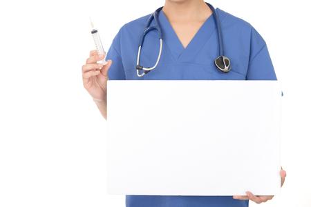 Female doctor holding injection needle Stock Photo
